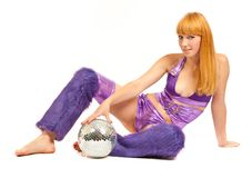 Beautiful young blonde holding a big disco ball Royalty Free Stock Images