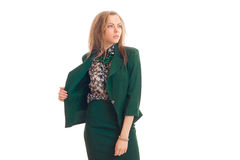 Beautiful young blonde looks away and keeps hand jacket green Stock Photography