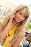 Beautiful young blonde with a mobile phone Royalty Free Stock Photos