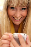 Beautiful young blonde with a mobile phone Royalty Free Stock Photo