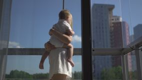 Beautiful young blonde mom playing with her baby boy son - Family values goal - Caucasian mother and child at home -. Smooth cinematic handheld movement stock footage