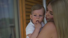 Beautiful young blonde mom playing with her baby boy son - Family values goal - Caucasian mother and child at home -. Smooth cinematic handheld movement stock video