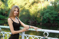 Beautiful young blonde in a park Stock Images