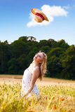 Beautiful young blonde Scottish girl in white dress at golden Royalty Free Stock Image