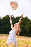Beautiful young blonde Scottish girl in white dress at golden wh Stock Photography