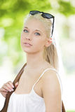 Beautiful young blonde teenage girl outdoor Stock Images