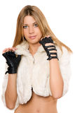 Beautiful young blonde in a white fur coat Stock Image