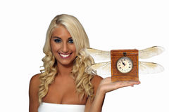 Beautiful Young Blonde with Winged Antique Clock royalty free stock image
