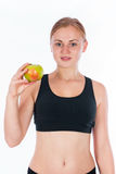 Beautiful young blonde woman with an apple in his hand Stock Images
