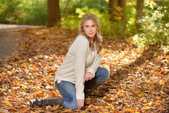 Beautiful young blonde woman - autumn Stock Images