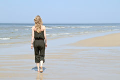 Beautiful young blonde woman at the beach Stock Photography
