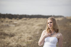 Beautiful Young Blonde Woman on Beach with White Dress Stock Photo