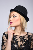 Beautiful young blonde woman in black hat Royalty Free Stock Photography