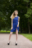 Beautiful young blonde woman in blue dress Royalty Free Stock Images