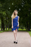 Beautiful young blonde woman in blue dress Stock Image