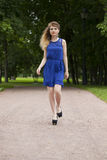 Beautiful young blonde woman in blue dress Royalty Free Stock Photography