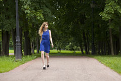 Beautiful young blonde woman in blue dress Royalty Free Stock Photo