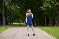 Beautiful young blonde woman in blue dress Royalty Free Stock Image