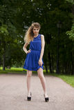 Beautiful young blonde woman in blue dress Stock Photography