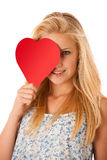 Beautiful young blonde woman with blue eyes holding red hart ban Stock Photo