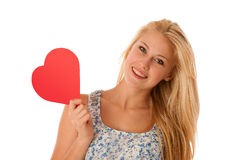 Beautiful young blonde woman with blue eyes holding red hart ban Royalty Free Stock Photo
