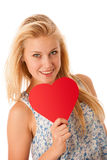 Beautiful young blonde woman with blue eyes holding red hart ban. Ner for valentines day isolated over white Stock Images