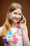 Beautiful young blonde woman calling by phone Stock Photos