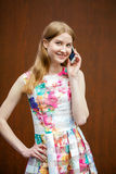 Beautiful young blonde woman calling by phone Stock Photo