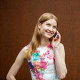 Beautiful young blonde woman calling by phone Royalty Free Stock Photography