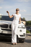 Beautiful young blonde woman with car key Royalty Free Stock Photography