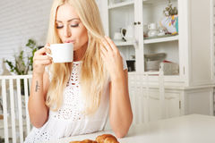 Beautiful young blonde woman enjoying a fresh Royalty Free Stock Photography