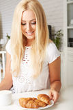 Beautiful young blonde woman enjoying a fresh Stock Photo