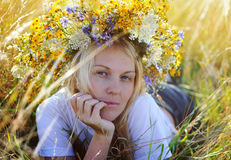 Beautiful young blonde woman with flower wreath on head Royalty Free Stock Images