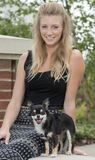 Beautiful young blonde woman with her adorable small dog Royalty Free Stock Images