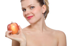 Beautiful young blonde woman holding a red apple Stock Image