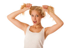 Beautiful young blonde woman holds hair in her hand gesturing ex Stock Images