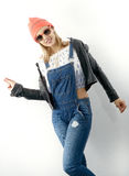 Beautiful young blonde woman with jeans overalls Royalty Free Stock Images