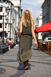 Beautiful young blonde woman in long dress Stock Images