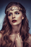 Beautiful young blonde woman with long hair with a diadem in the Greek style Stock Photography