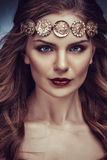 Beautiful young blonde woman with long hair with a diadem in the Greek style Royalty Free Stock Photo