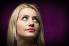 Beautiful young blonde woman looking up Royalty Free Stock Images