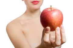 Beautiful young blonde woman offering red apple Stock Photography