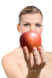 Beautiful young blonde woman offering red apple Stock Images