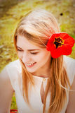 Beautiful young blonde woman. Outdoor with a tulip Stock Photography