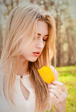 Beautiful young blonde woman. Outdoor with a tulip Royalty Free Stock Image