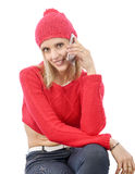 Beautiful young blonde woman with a red cap, phone Royalty Free Stock Photography
