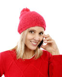 Beautiful young blonde woman with a red cap, phone Stock Images