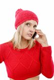 Beautiful young blonde woman with a red cap, phone Royalty Free Stock Photos