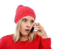 Beautiful young blonde woman with a red cap, phone Stock Photos