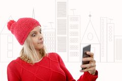 Beautiful young blonde woman with a red cap, phone Stock Photo